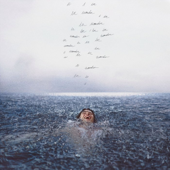 The album cover for Shawn Mendes' Dec. 4 album Wonder. The cover shows Mendes floating with a smile on his face as handwritten lines display variations of the phrase