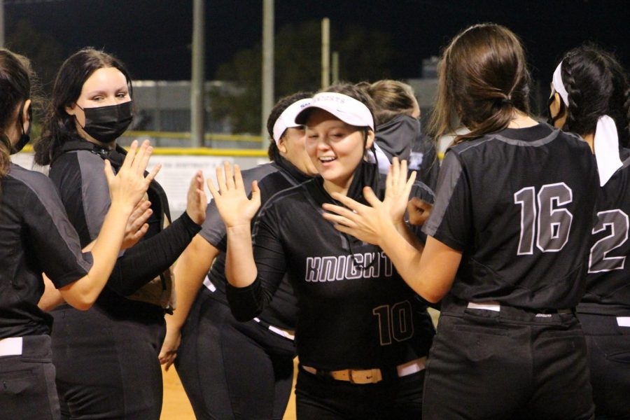Kouhana Pousson ('23) is cheered on by her teammates as she takes to the field.