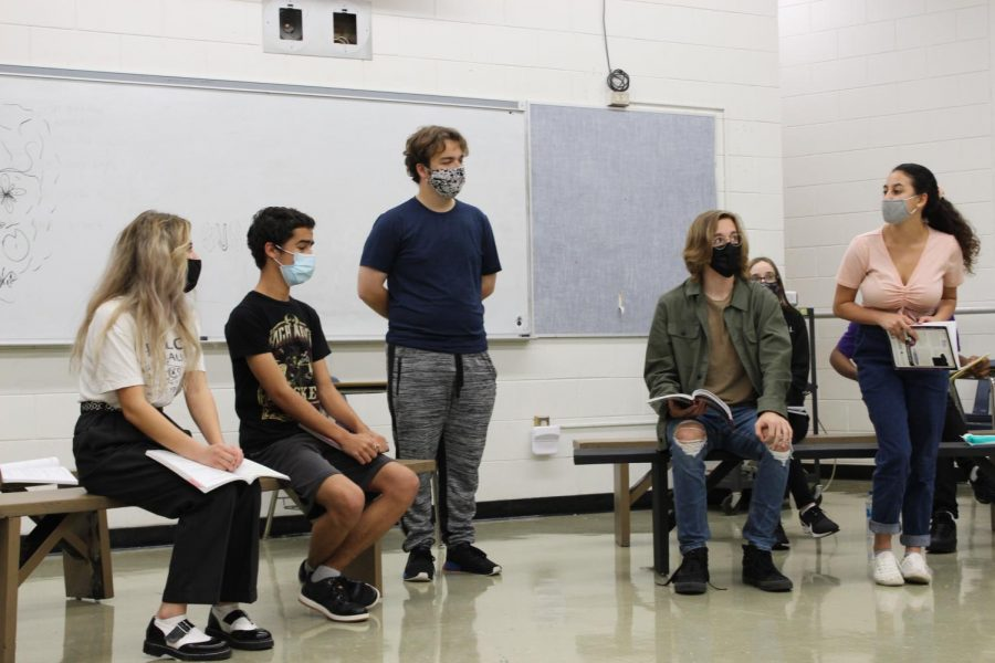From left to right: Lucy Frank ('22), Elias Fermin ('21), Charles Davidson ('21), Peyton Heckman ('23) and Jaden Fernandez ('23) practice blocking and lines for a scene of Legally Blonde. Despite recording Legally Blonde in a movie format, Troupe 2660 still holds rehearsals as if they were performing live.