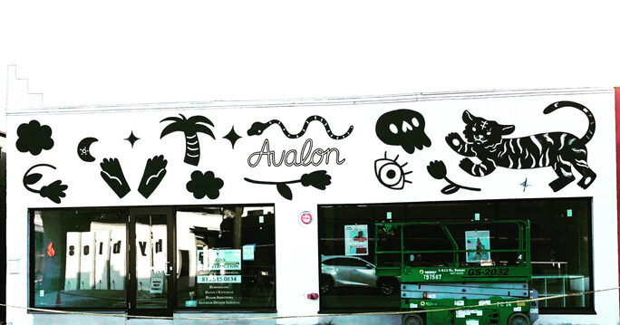 The exterior of Avalon Exchange, complete with murals and located on MacDill Ave.
