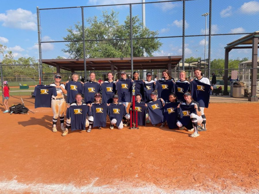 The softball team poses with their second place trophy and tee-shirts while they were at the Longshore Tournament. From April 16-17, the team played tough competition from across the state.