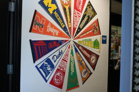 A wheel of college banners in Robinson's guidance counselor office.