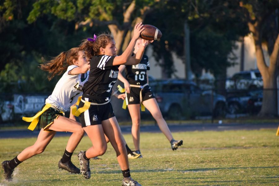 Isabella Dolce ('21) catches a pass from Sydney Stout ('21).