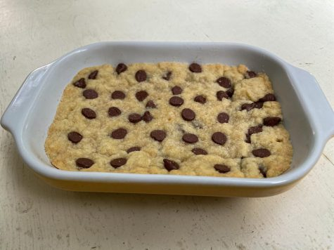 The completed bars fresh out of the oven, with chocolate chips slightly melted on top.