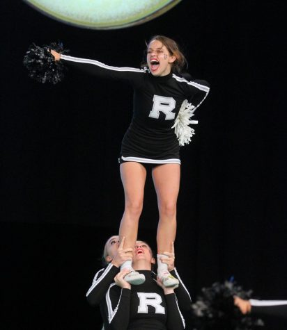 Hoisted in the air by her teammates, Alison Quigley (22) chants during a routine. Next season, I hope everyone comes in with the expectation to win [Nationals] because it is so possible if the team makes the extra efforts to do their jobs, she said.