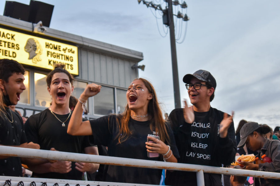 (From left to right) Gabe Guiteirrez-Sanchez (23), Diego Hernandez (23), Cassidy Chapman (23) and Alex Galvin (23) cheer on the Robinson marching band as they play in the stands. After being an eLearner for a year, I definitely missed the community feeling we have. I really missed the student sections school spirit. I definitely felt like Im really back at school now, Chapman said.