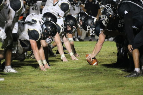 """Plant and Robinson's varsity football teams line up head to head waiting for the referee to blow the whistle. Robinson was losing, but that didn't stop the players from putting forth all of their effort. """"I'll get it done right, and I'll make the other team pay,"""" Varsity Center Hunter Brown (22) said."""