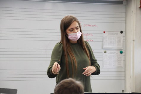 Stow conducting one of her orchestra classes.