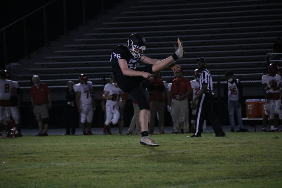 Robinson Knights kicker Gunnar Gibson (22) practicing his punts for the game against East Bay during halftime