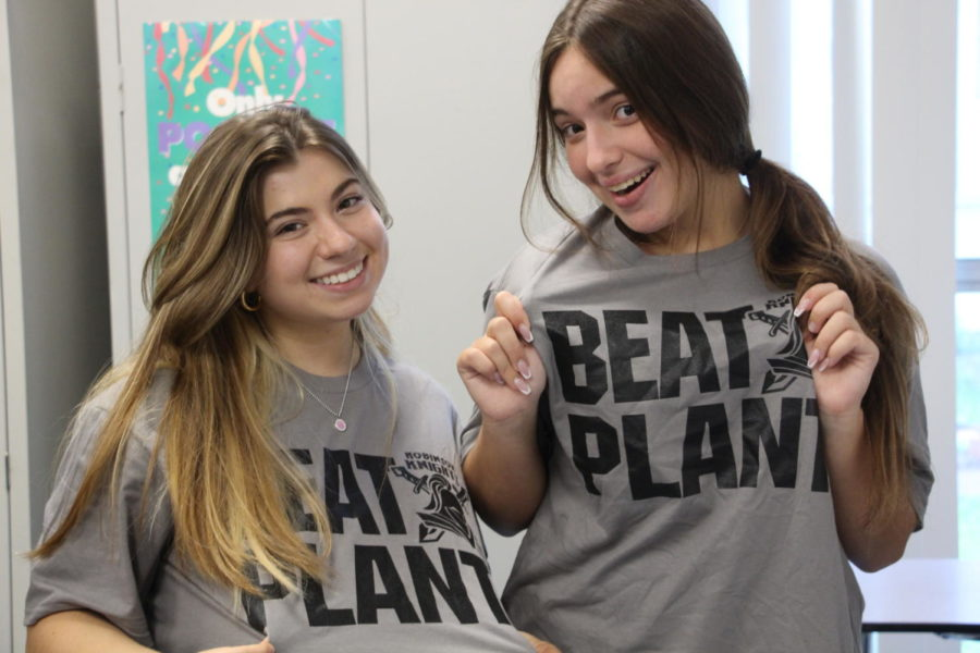 """Juniors Callie Tipton and Hailey Green show off their """"Beat Plant"""" t-shirts the morning of the big rival game."""