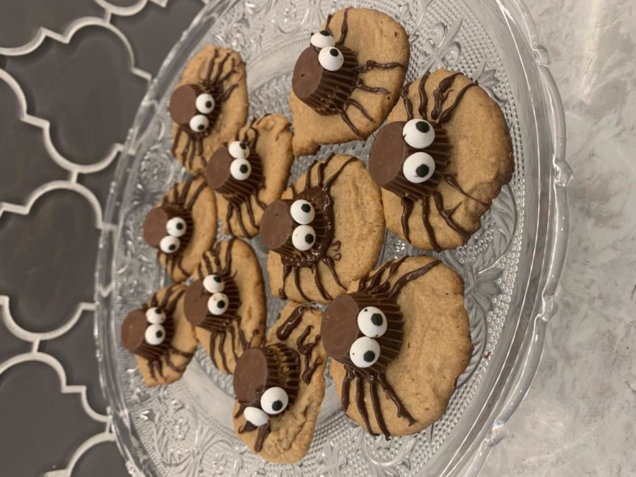 The peanut butter spider cookies are placed on a platter to cool. They are made just hours before a Halloween party, and they look delectable.