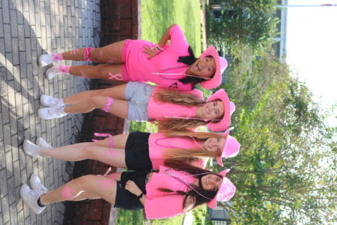 Trinavy Le ('22), Tate last name ('22), Angelina Fentress ('22) and Bailey Williams ('22) looking pink-a-licious in pink cowgirl hats for pink out day.