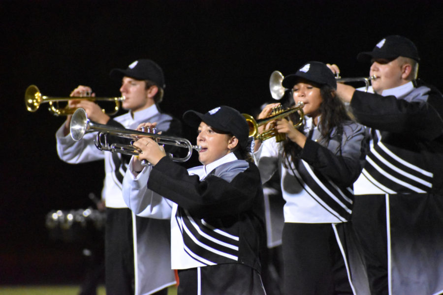The Trumpet section performs their show By The Sword during halftime.